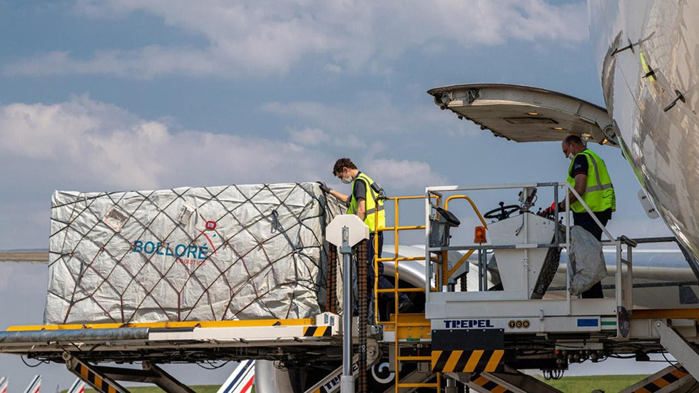 "The boxes of ""Made in Vietnam"" masks are loaded The words ""Made in Vietnam"" are printed on the outside of each box in France from the transport plane - Photo: Bolloré"
