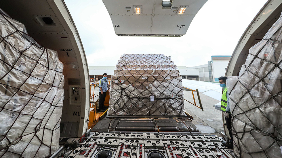 The packages are housed in the cargo holds of the transport planes, each small with about 500 masks